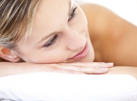 Close-up of a beautiful woman lying on a massage table